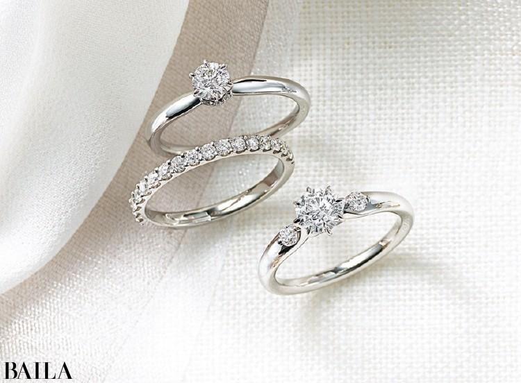 センターダイヤモンドの台座の下で、アームが結び目を作るようなデザイン。