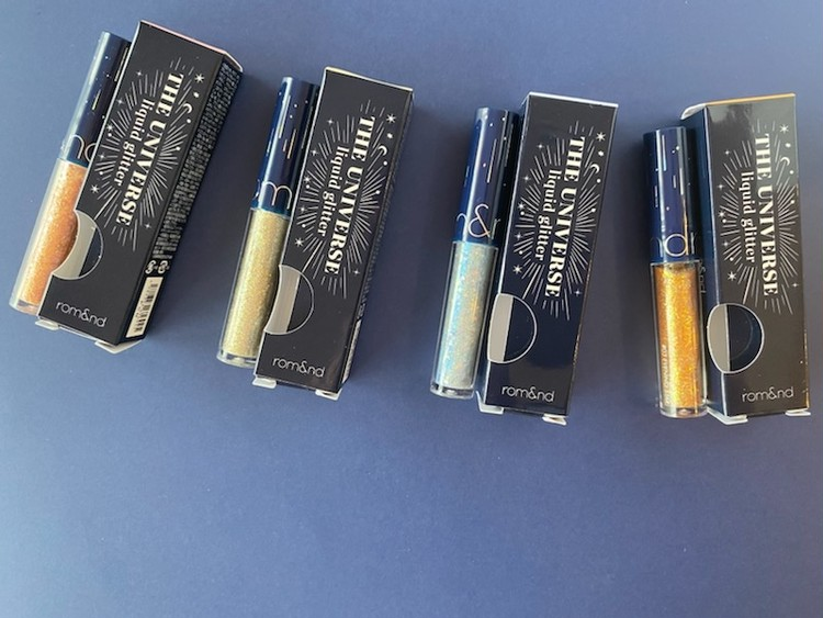 「rom&nd」(ロムアンド)「 ザユニバース リキッドグリッター」の「01 スターダスト」、「02ローズスター」、「03 イブニングスター」、「04 フローズンスター」の全4色のパッケージ