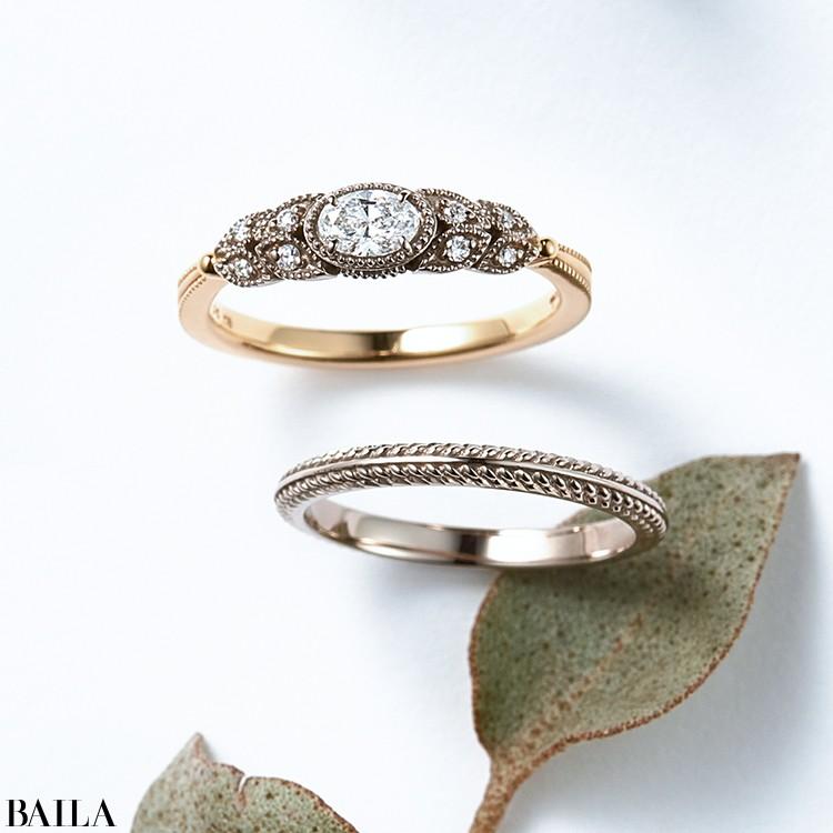 繊細にミル打ちを施し、メレダイヤをちりばめた台座にオーバルダイヤモンド