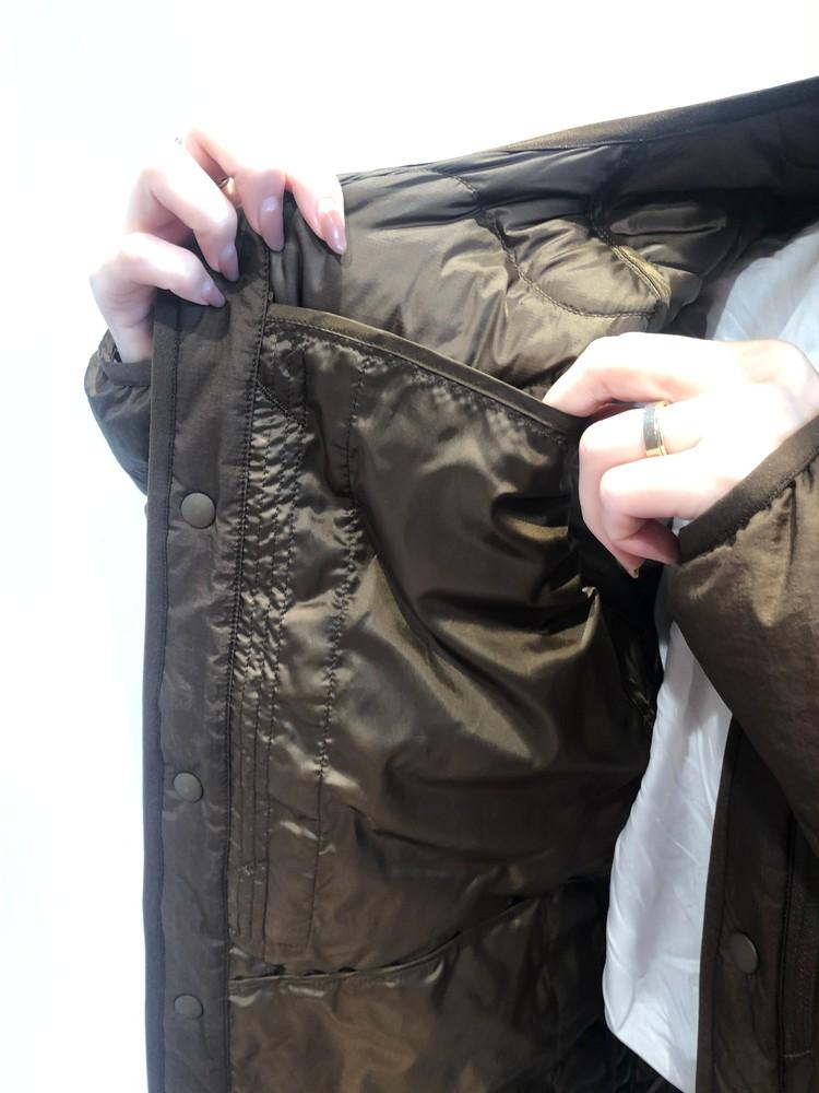 ユニクロコラボホワイトマウンテニアリングのウルトラライトダウンオーバーサイズジャケットの内側